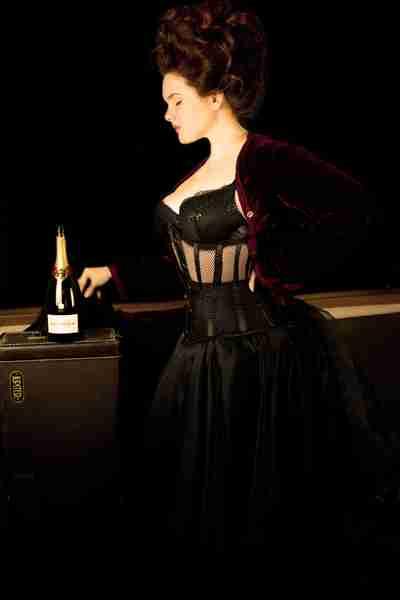 side view of the corset model Elizabeth Barrett-Smyth wearing the new Gallery Serpentine Dark Desire mesh corset