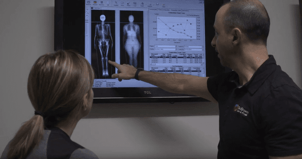 Man and Woman Looking at Body Screen