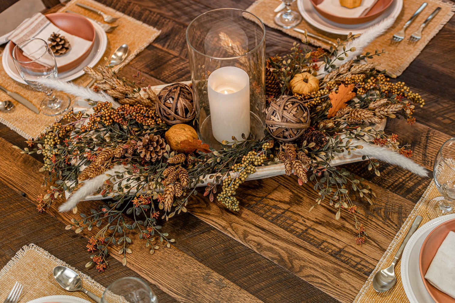 fall table centerpiece with candle rattan balls and fall florals