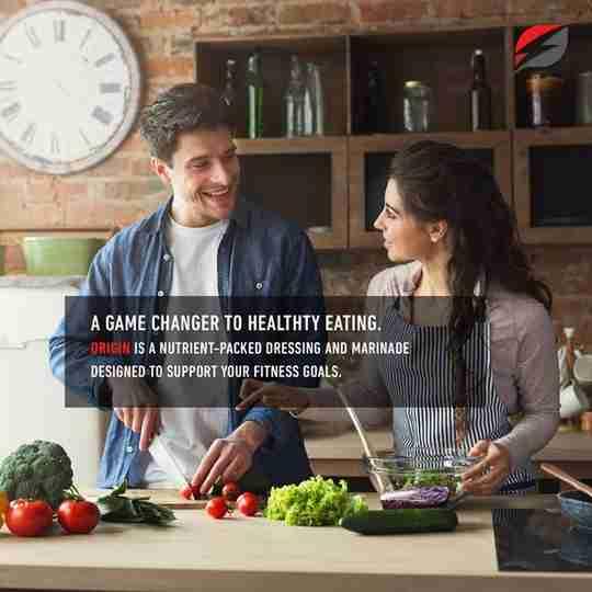 Strength Genesis Origin Keto Salad Dressing & Marinade Ad Two People Making Salad Together in Kitchen