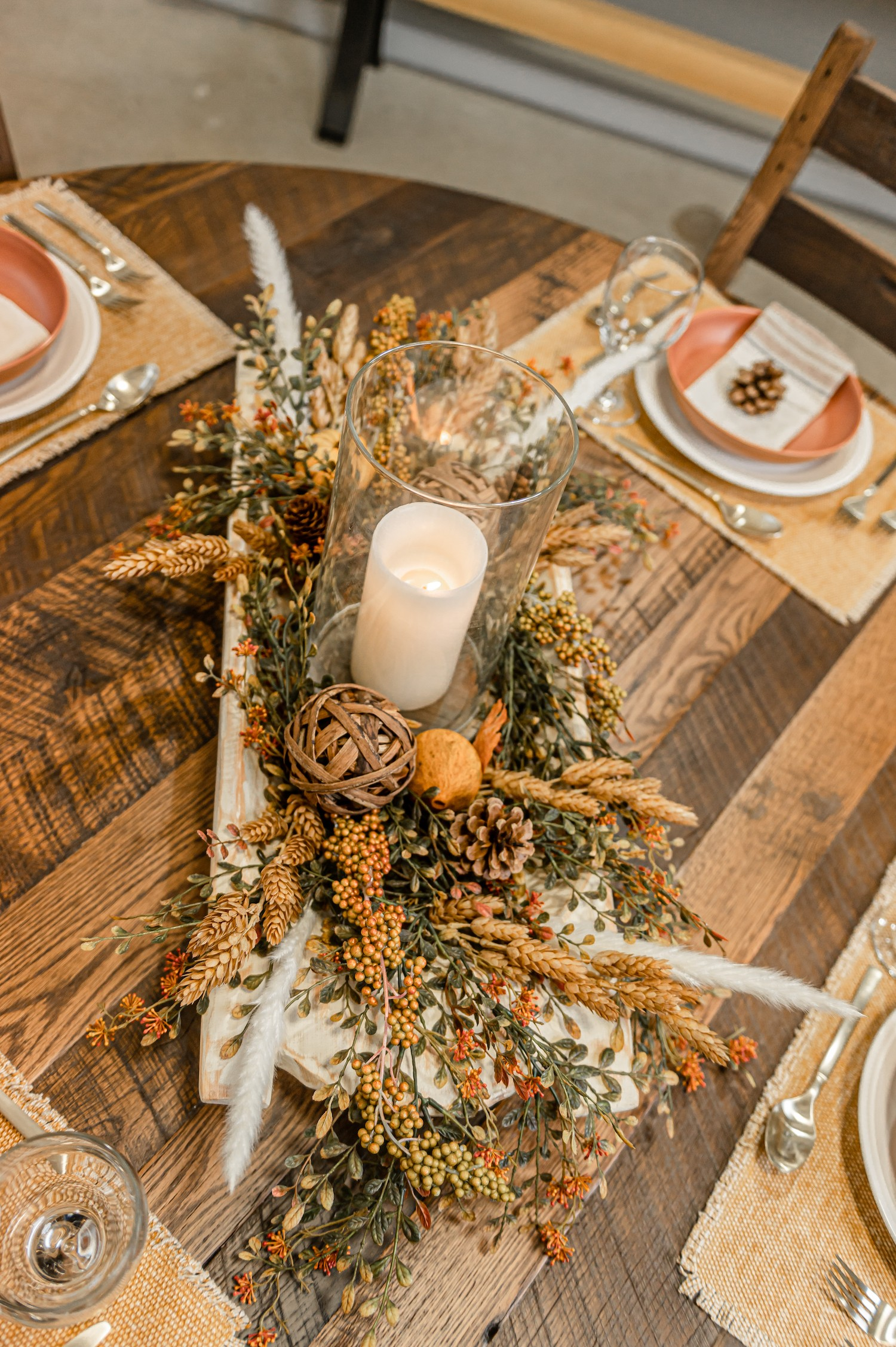 fall centerpiece inspiration luminaire style candle within a glass huricane