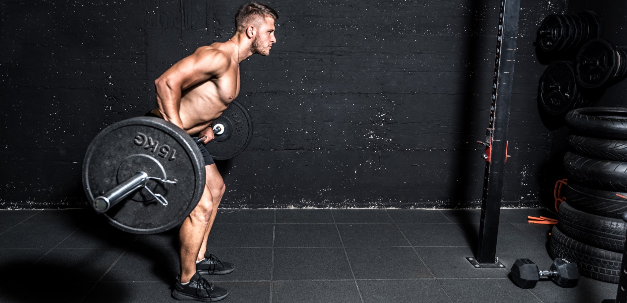 An athlete lifting weight to boost testosterone levels naturally