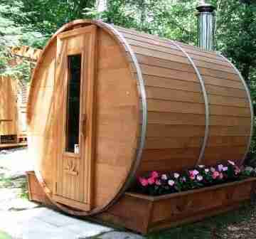 Image of a charming barrel sauna in an outdoor setting