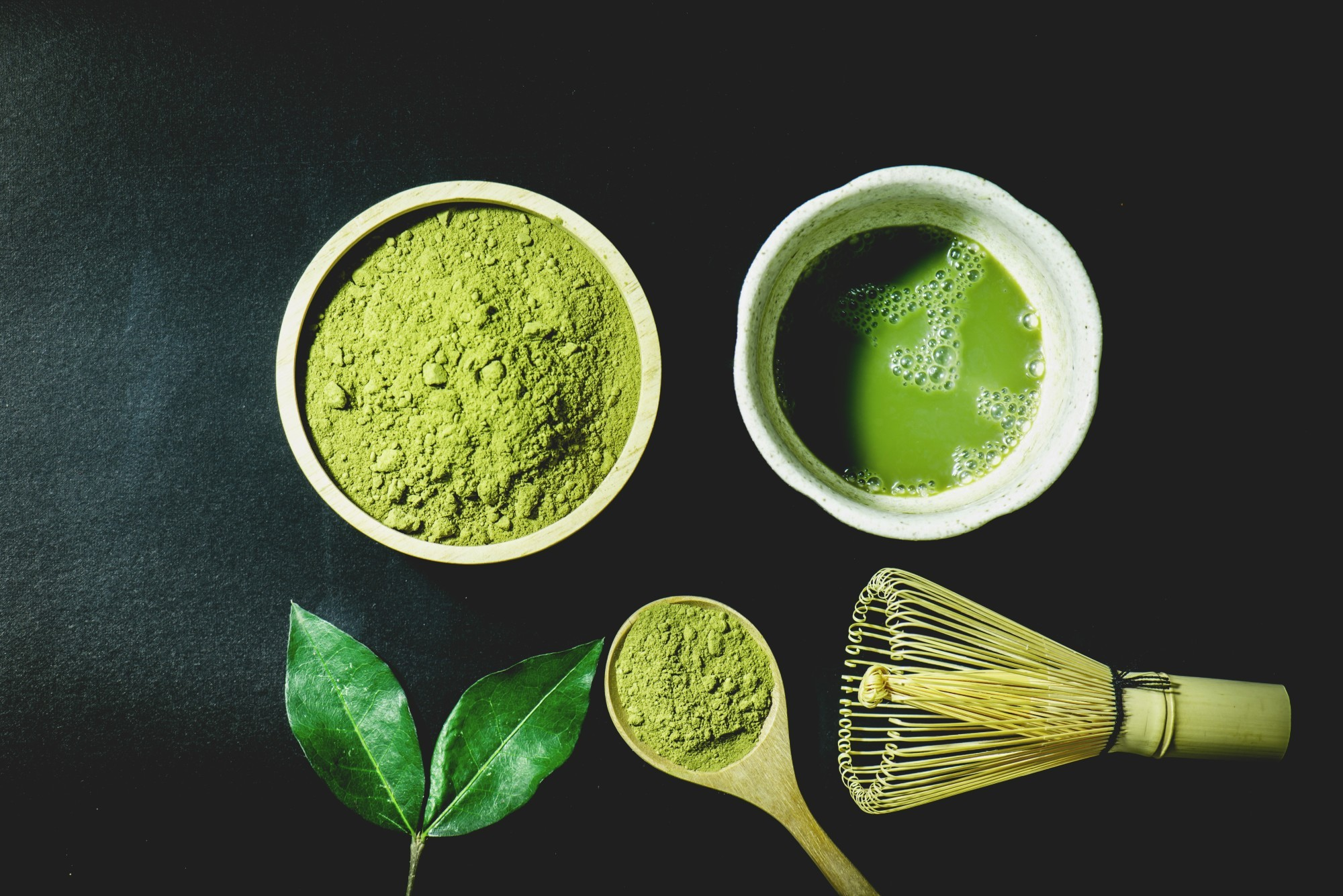 Japanese Matcha powder, leaves, spoon and powder