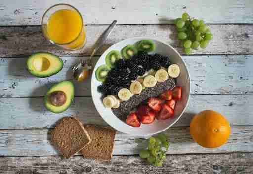 healthy yogurt bowl with fruits and whole grain toast