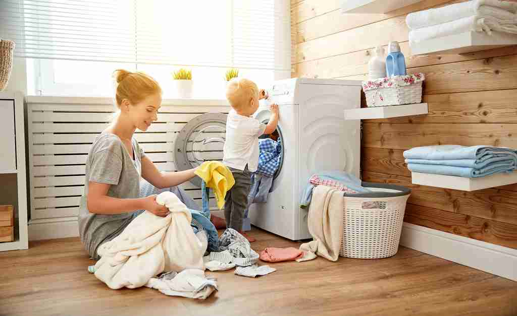 Mom doing the laundry with her child