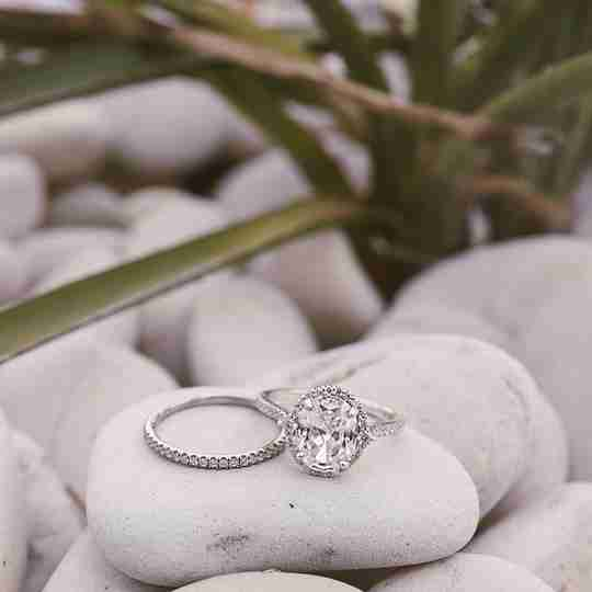 A wedding and engagement ring from James Allen on pebbles
