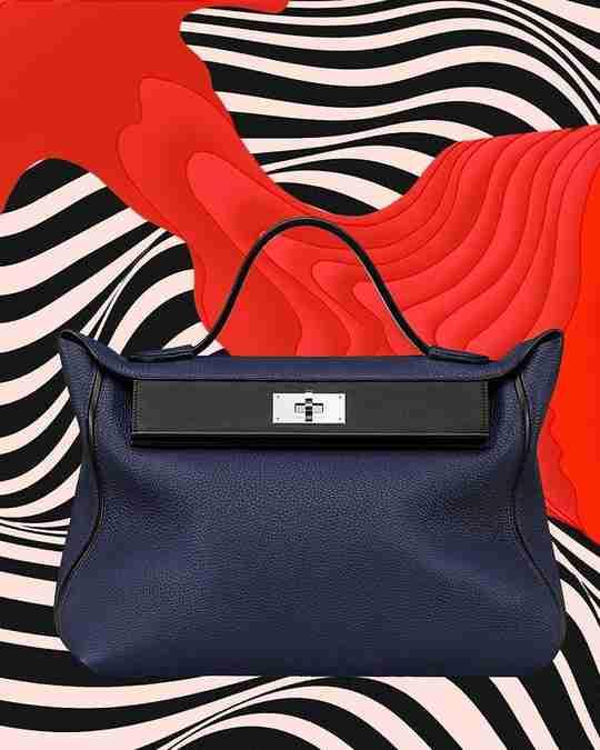 A navy blue Hermès Kelly bag