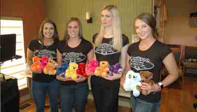 Employees holding our Colorama Bears.