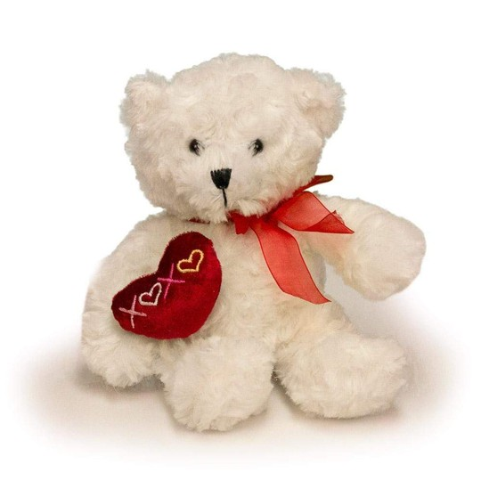 A white bear with an embroidered heart that says XOXO.