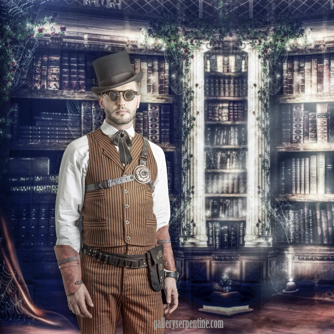Outlaw Vest and matching pants in tan worn with top hat, steampunk sunglasses
