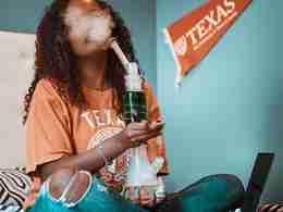 woman smoking a bong