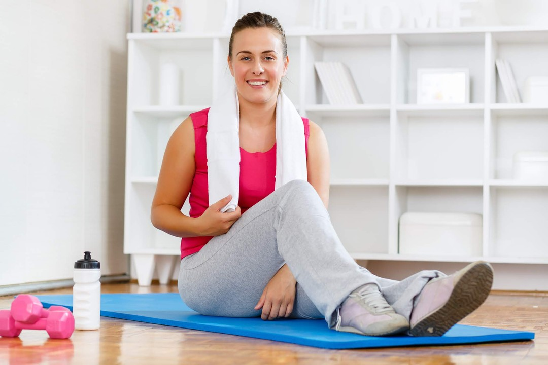 a fit looking woman on her Yoga mat