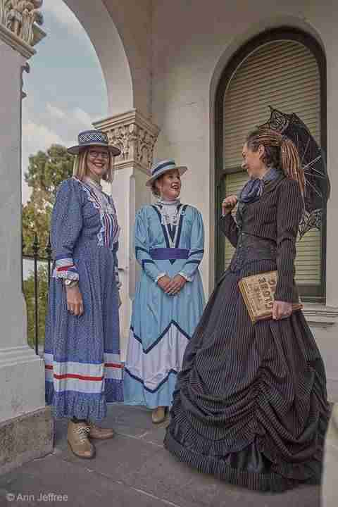 Tessa Ambrose History Tours Guide at the Clunes Booktown Festival wearing Gallery Serpentine's Pinstripe Victorian Wedding Dress