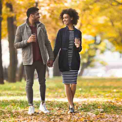 Woman and man out walking in autumn
