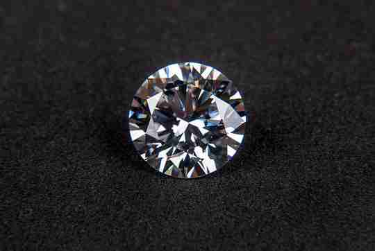 Diamond on fabric background