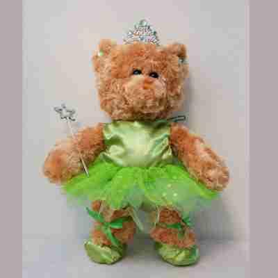 Beige bear with a green dress.