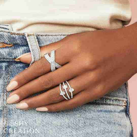 A woman wearing stackable Rogers & Hollands rings