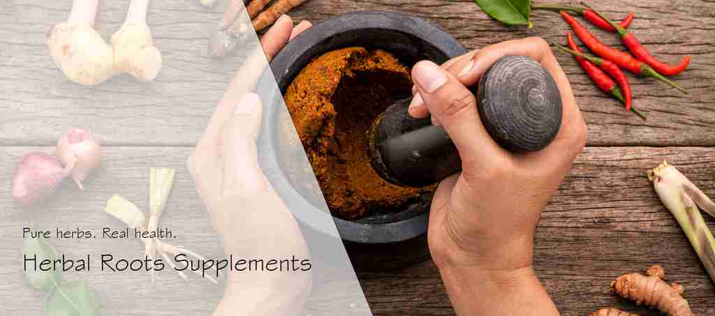 Hands using mortar and pestle with herbs around