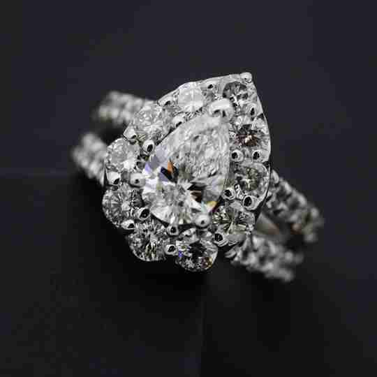 Pear-shaped diamond with round diamond accents