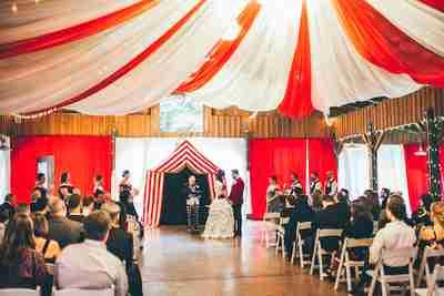 Julia & Kurtis being married under the Big Top