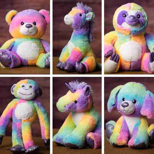 Six animals with fur that looks like Rainbow Sherbet ice cream: teddy bear, giraffe, sloth, monkey, unicorn and dog.