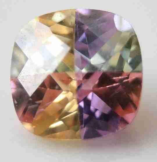 A multicolored cubic zirconia gemstone