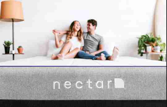 couple laughing on nectar mattress available at sleep first