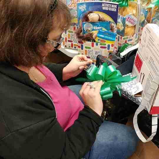 Woman making a gift basket