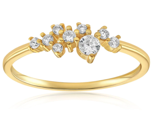 Gold ring with multiple gemstones in the middle