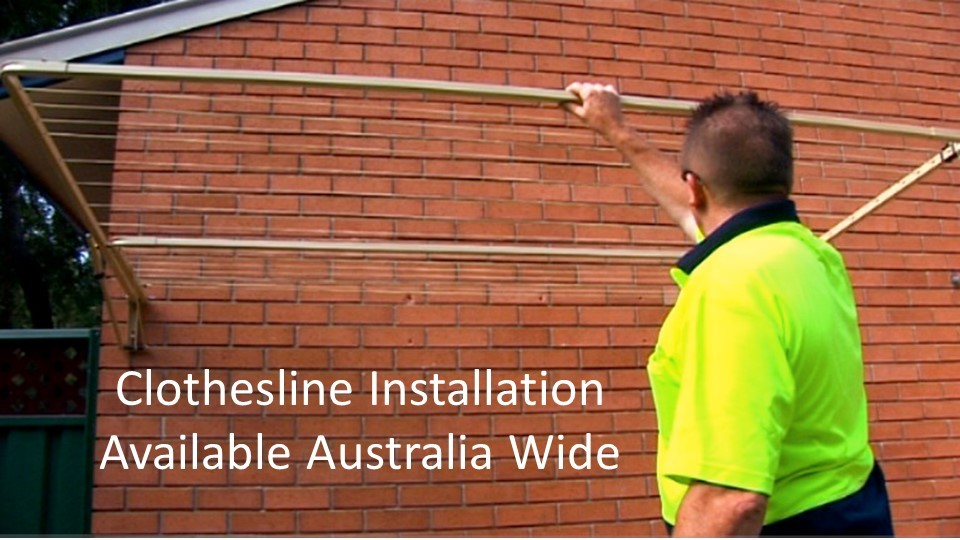 2.3m wide clothesline installation service showing clothesline installer with clothesline installed to brick wall