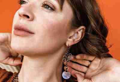 Flash Sale on Unique Handmade earrings; image of woman wearing copper earrings
