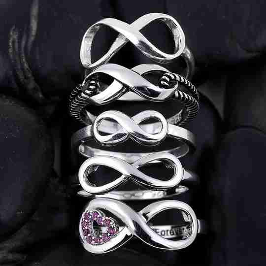 A stack of silver infinity rings