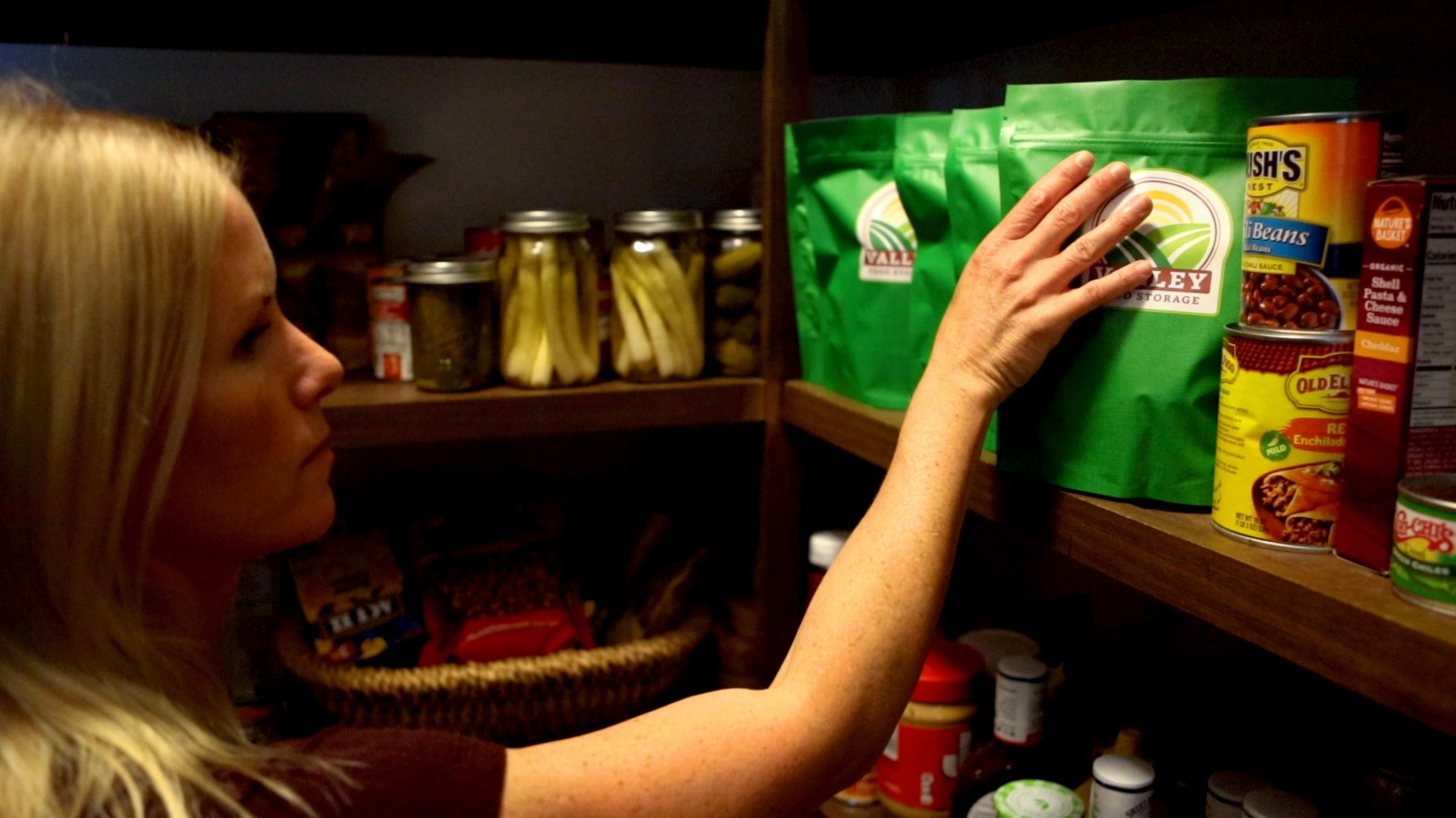 Woman getting Valley Food Storage Emergency Food Bags out of her pantry