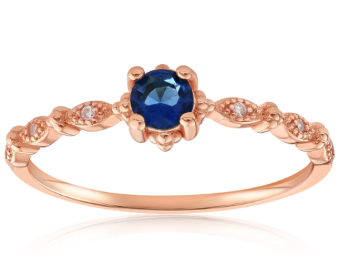 Rose gold vermeil ring with topaz center stone