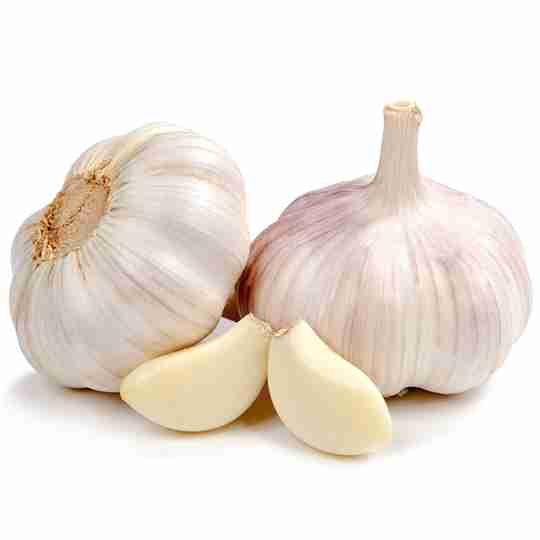 Garlic bulbs with cloves on white background
