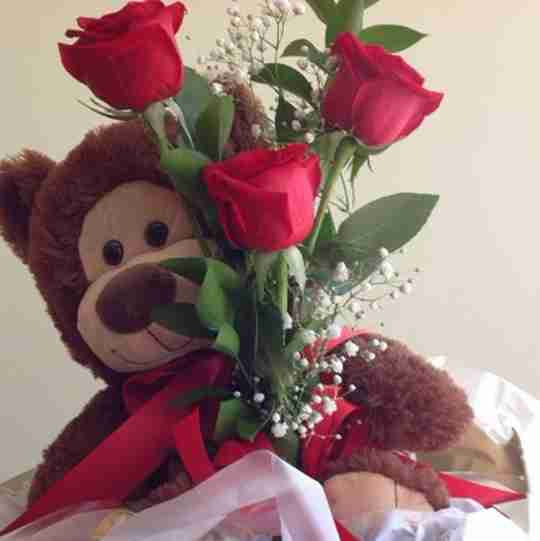 Bear with roses.