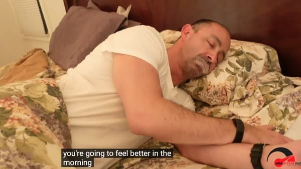 Man Sleeping In Bed With Tape on Mouth