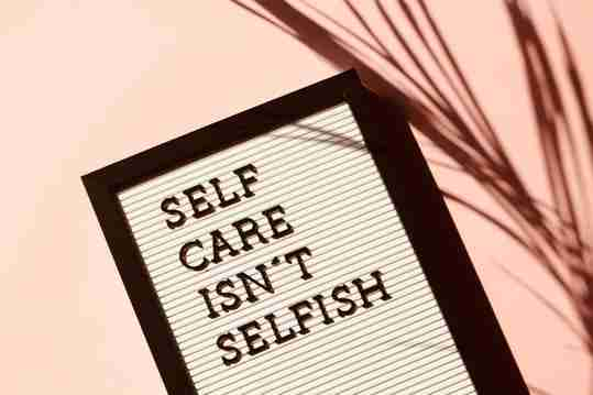 "A sign that says ""Self care isn't selfish"""
