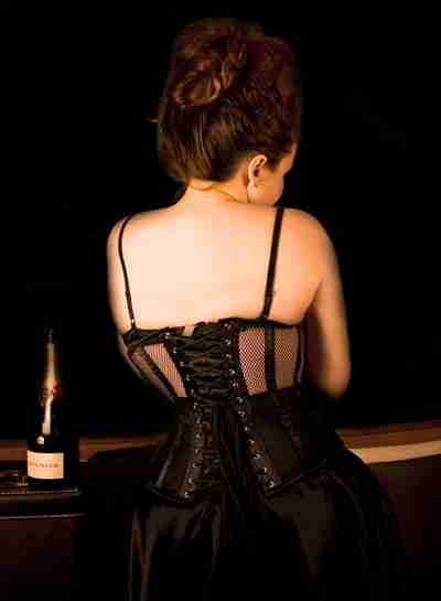 Elizabeth corset model wearing the Dark Desire Mesh corset showing the back view of the corset
