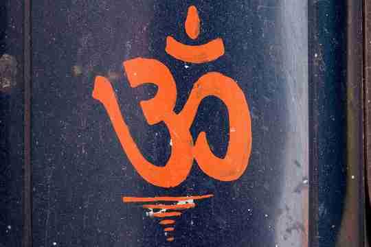 Om symbol on a blue background