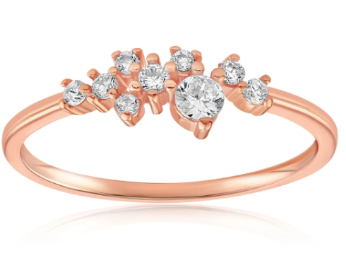 Rose gold vermeil ring with gems designed semi pave on each side of the center stone
