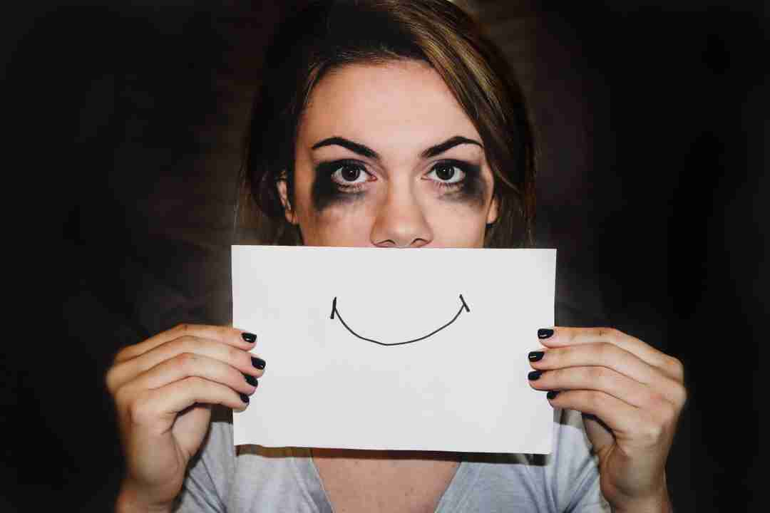 Woman with a happy face sign