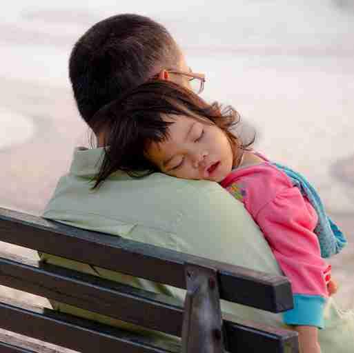 Kid sleeping on dads shoulder