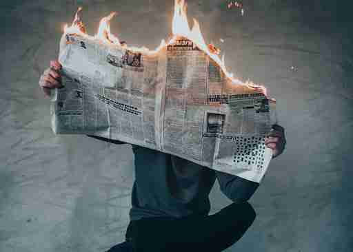 man reading the 2020 news on fire