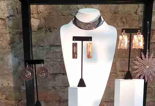 A jewelry display at Junebug Jewelry Designs storefront at 1327 Vine Street in Cincinnati, Ohio