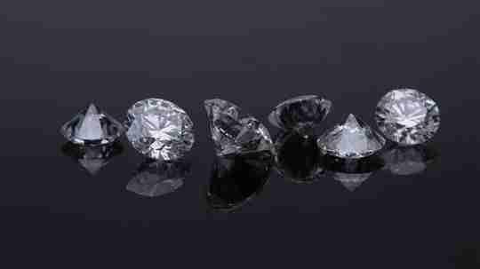 Six diamonds on black background