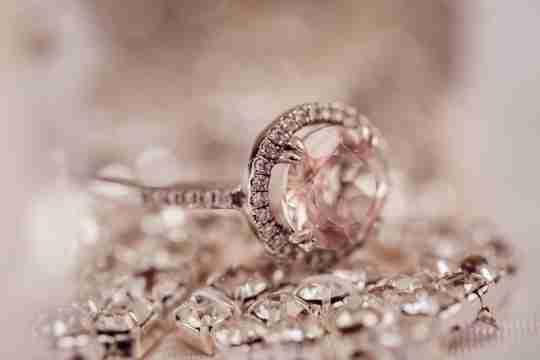 Pink diamond ring on fabric