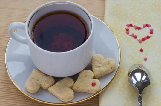 rooibos rocks cup of tea with heart cookies