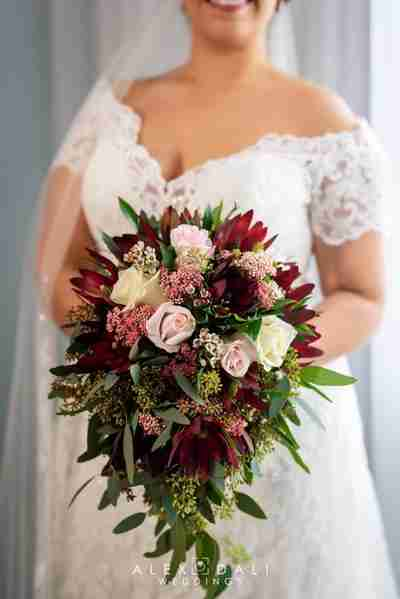 A bride holding a bouquet of roses